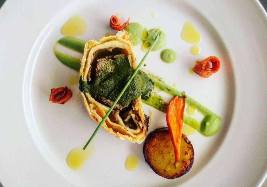 Lamb Wellington with Fondant Potato, Sweet Baby Carrots, Pea Puree & Mint Sauce